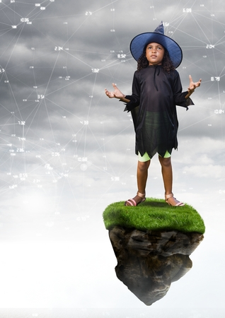 Digital composite of Young witch halloween Girl on floating rock platform  in sky with connectors interface