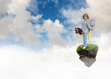 Digital composite of Young child dressed as a knight playing on floating rock platform  in sky with connectors interface