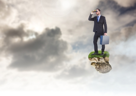 Digital composite of Businessman with binoculars on floating rock platform in sky
