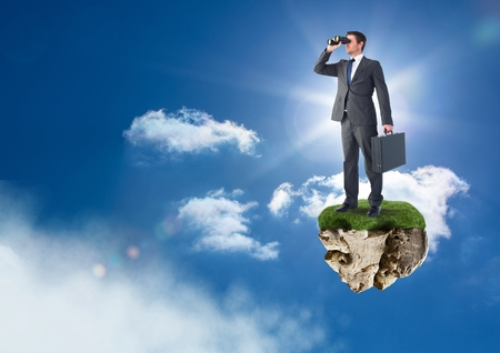 Digital composite of Businessman with binoculars on floating rock platform in sky