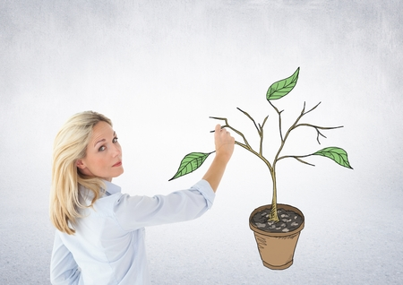 Digital composite of Woman holding pen and Drawing of Plant branches and leaves on wall Stock Photo - 86571865