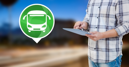 Digital composite of Holding tablet with bus icon by road Stock Photo
