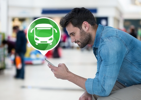 Digital composite of Man holding phone with bus icon Imagens