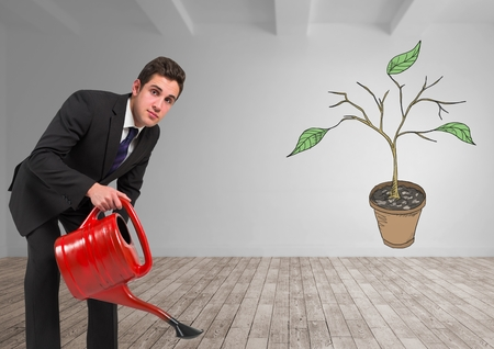 Digital composite of Man holding watering can and Drawing of Plant branches and leaves on wall Stock Photo