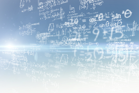 Maths on black background against blue and yellow sky Stock Photo