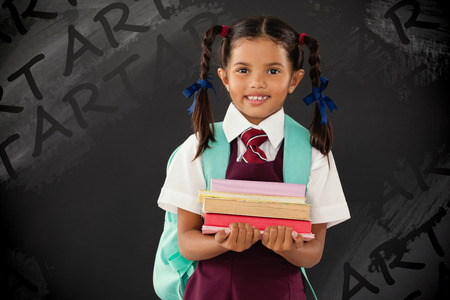 girl laptop: Graphic image of art text against portrait of schoolgirl in school uniform holding books against blackboard Stock Photo