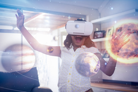Composite image of solar system against white background against cheerful girl wearing virtual reality simulator in living room