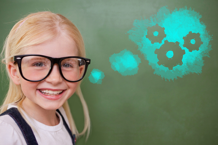 aviators: Cute pupil smiling against digital composite image of gears on blue spray paint