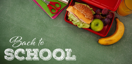 Back to school text over white background against overhead view of burger in lunch box Stock Photo