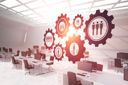 Digital composite image of gears with human representations against computers in office