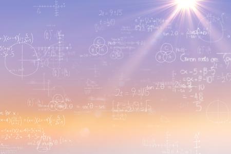Formulas on black background against sunrise sky Stock Photo