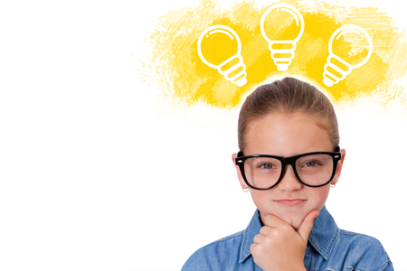 Cute pupil thinking against illustration of light bulbs on yellow spray paint