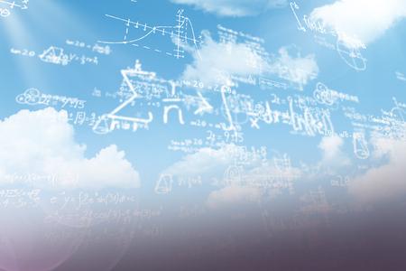 Formulas against black background against blue sky Stock Photo