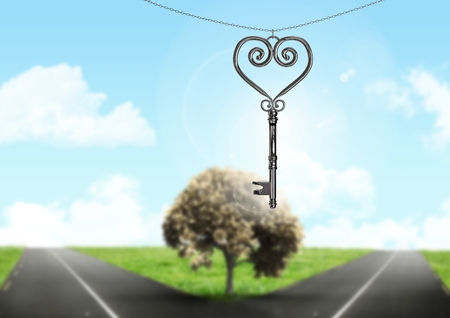 Digital composite of 3D Heart Key floating over parting road