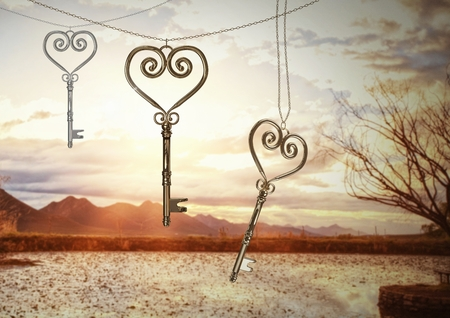 Digital composite of 3D Heart Keys floating over  mountains and tree landscape Stock Photo