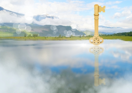 Digital composite of 3D Key floating over lake Stock Photo