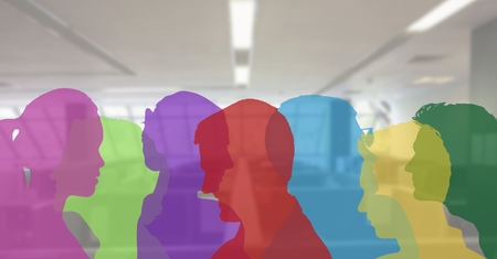 Digital composite of color silhouette of people in the office