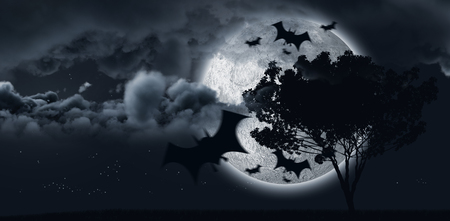 Digital image of silhouette bat against shining moon hides by a tree and some clouds Banco de Imagens