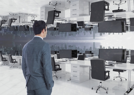 swivel: Digital composite of businessman standing in inverted office with skyline
