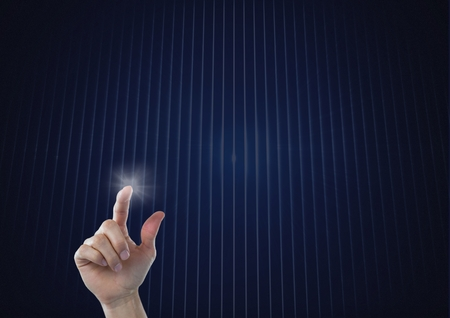 Digital composite of Hand touching the air with glow Stock Photo