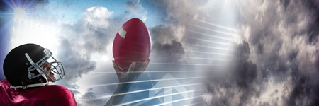 Digital composite of American football player with sky transition Stock Photo