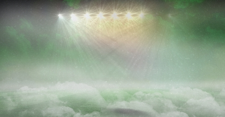 Digital composite of american football stadium in green smoke