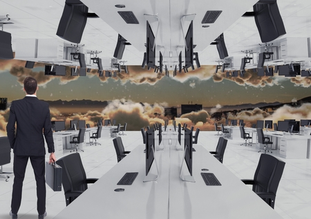 swivel: Digital composite of businessman standing in inverted office in the clouds with skyline Stock Photo