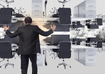 Digital composite of businessman standing in inverted office in clouds with flare