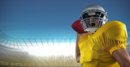 Digital composite of american football  player standing in stadium throwing the  ball