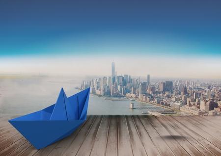 Digital composite of Paper boat over city