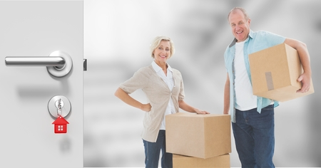 Digital composite of people moving boxes into new home Reklamní fotografie