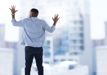 Digital composite of Businessman touching invisible wall over city