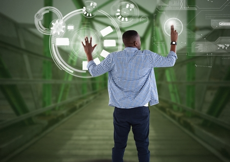 Digital composite of Businessman touching interface on green bridge Stock Photo