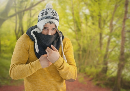 Digital composite of Man in Autumn with hat and scarf in forest