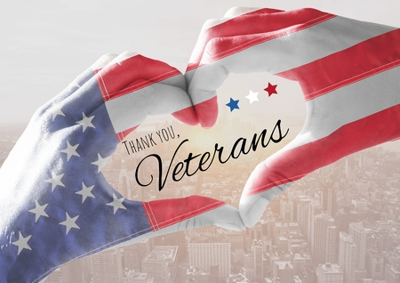 Digital composite of Veterans day, flag usa on hands with text Фото со стока
