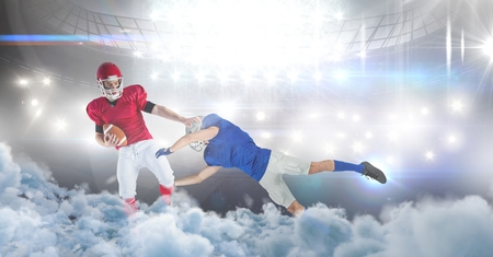Digital composite of american football players in stadium tackle