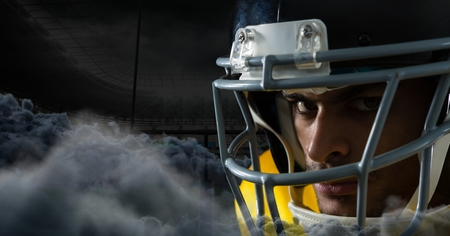 Digital composite of american football player with clouds in stadium Stock Photo