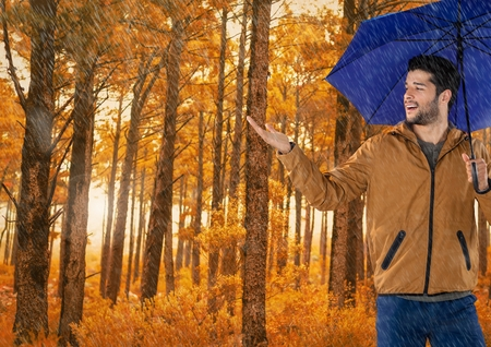 Digital composite of Man in Autumn with umbrella in forest