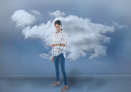Digital composite of Businesswoman checking the time on watch with clouds