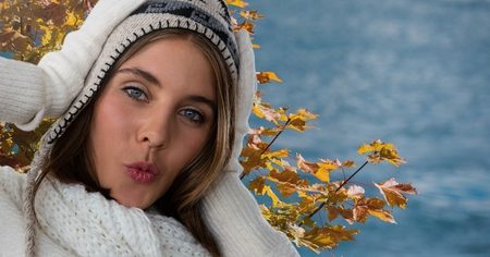 Digital composite of Woman in Autumn with hat and hood with tree leaves