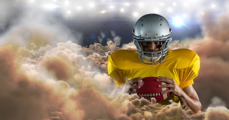 Digital composite of american football player in clouds