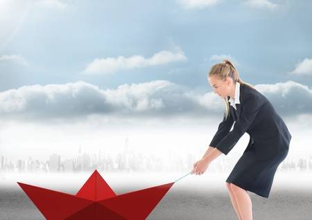 career fair: Digital composite of Businesswoman pulling paper boat with rope in city Stock Photo