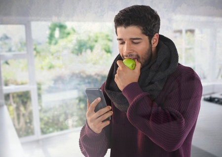 Digital composite of Man in Autumn with apple and phone at home