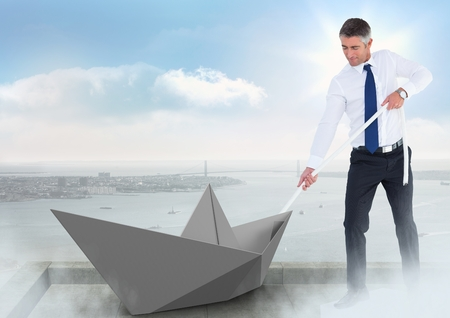 Digital composite of Businessman pulling paper boat with rope in city sky