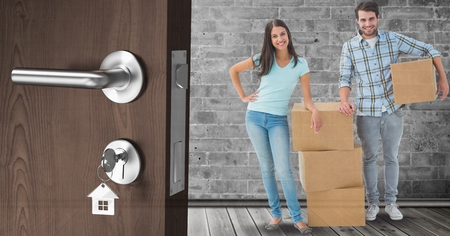 Digital composite of people moving boxes into new home Stock Photo