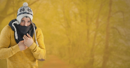 Digital composite of Man in Autumn with hat and scarf in yellow forest Stock Photo