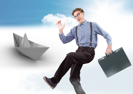 Digital composite of Businessman with briefcase and paper boat in sky