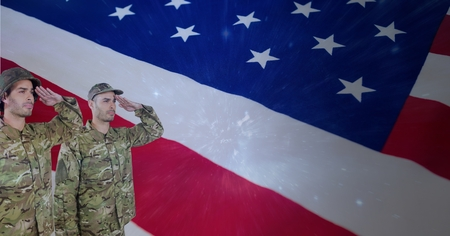 Digital composite of veterans day soldiers in front of flag