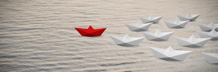 Digital composite image of paper boats against full frame shot of sea