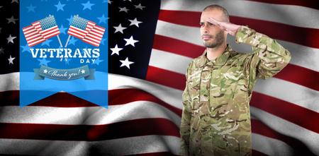 Soldier giving salute for veterans day in america Reklamní fotografie